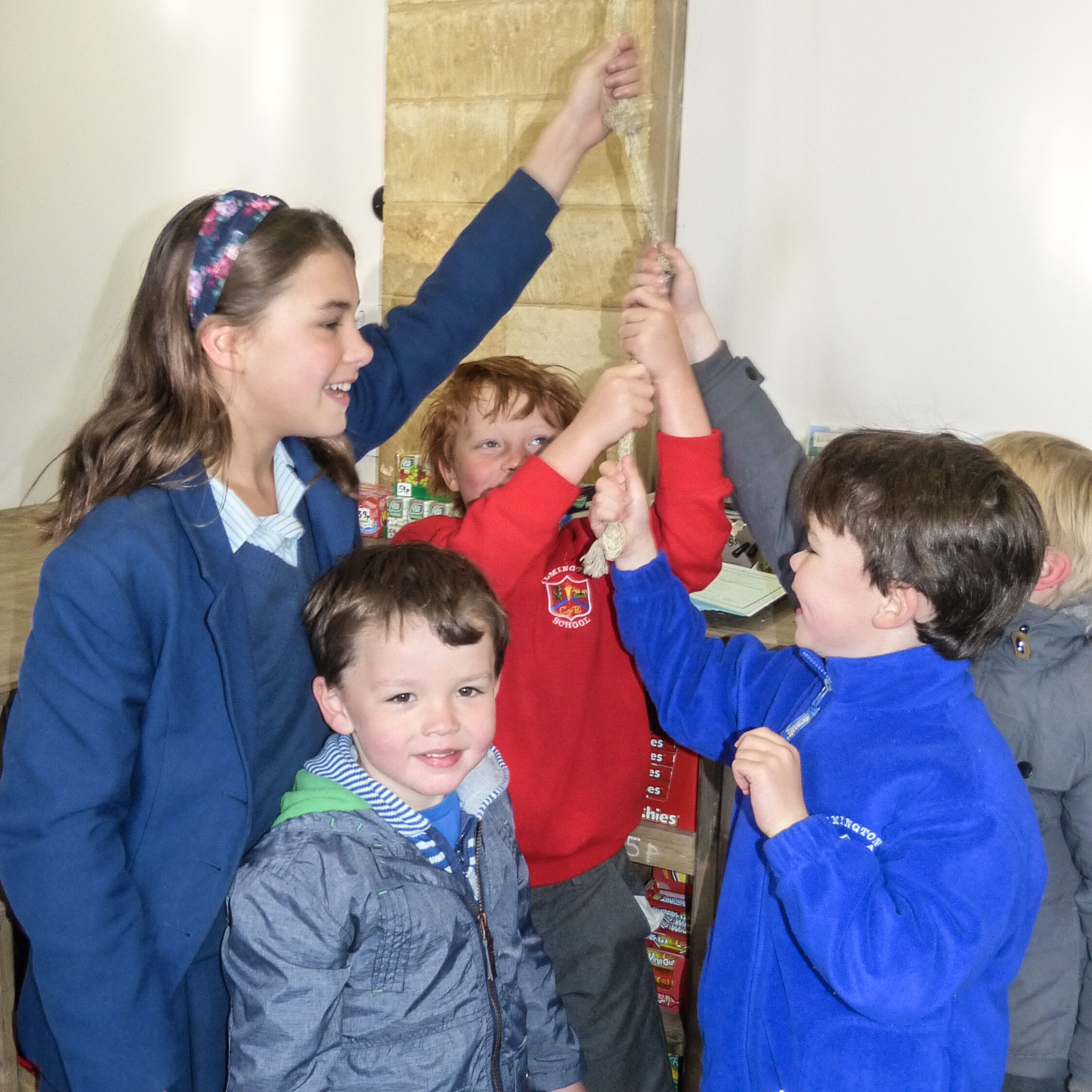 Local children ringing the bell to celebrate opening